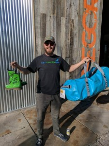 Green Riverkeeper Gray Jernigan showing off the trophies and prizes for volunteers participating in the Green River Spring Cleaning on April 8.